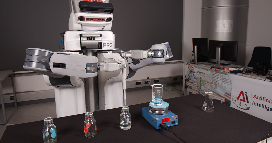 A robot works in a laboratory. He fills glasses with a pipette.