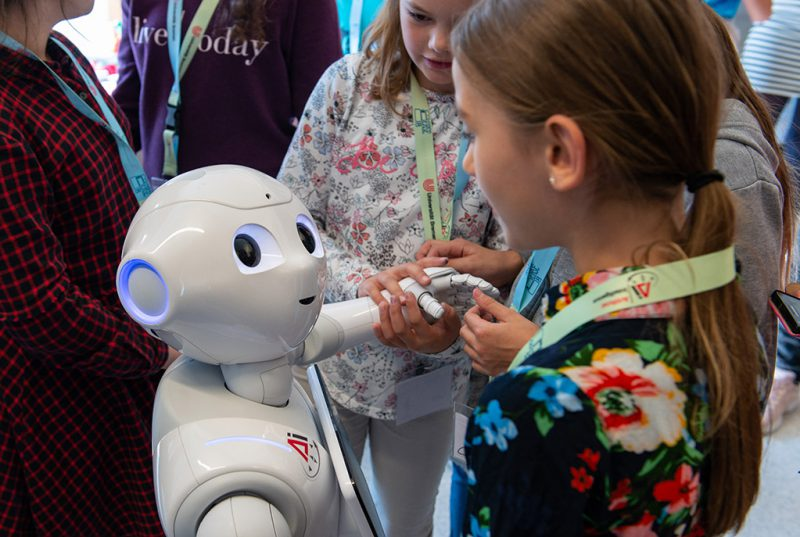 A girl interact with a humanoid robot