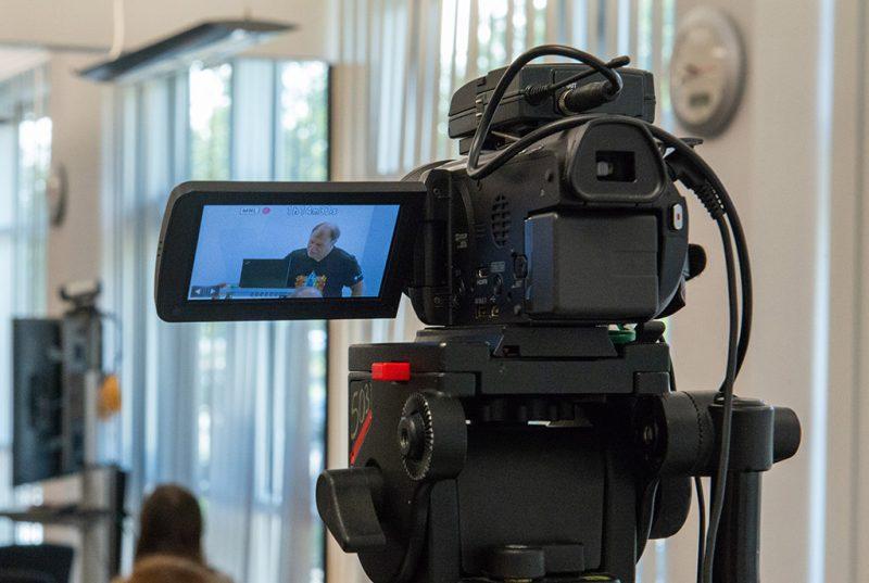 A camera films a lecture
