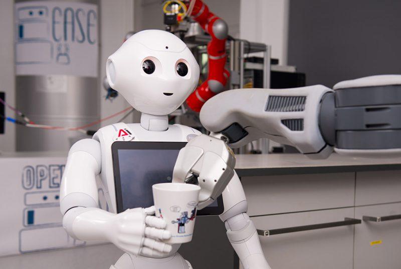 A robot get a cup from an other robot.